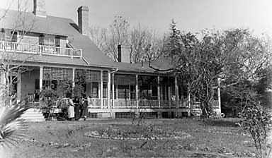Beadel House, circa 1920s, shows the addition and a circular pool in a mowed yard.