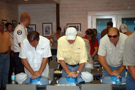 Plantation managers practice on CPR dummiers