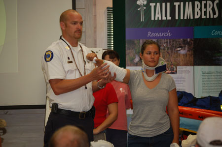EMS Sgt. Shane Weaver and Angie Reid demonstrate emergency procedures