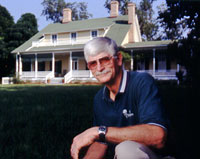 Executive Director, Lane Green, in front of the Beadel House at Tall Timbers.