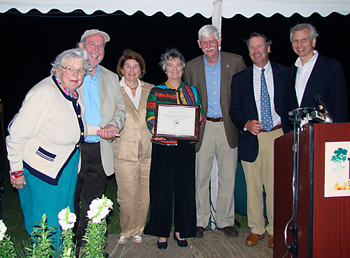 Land Trust Alliance President Rand Wentworth (r) presents the national land trust accreditation plaque to Tall Timbers.