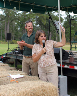Research Director and Emcee Bill and picnic judge Kathy Marois announcing winners