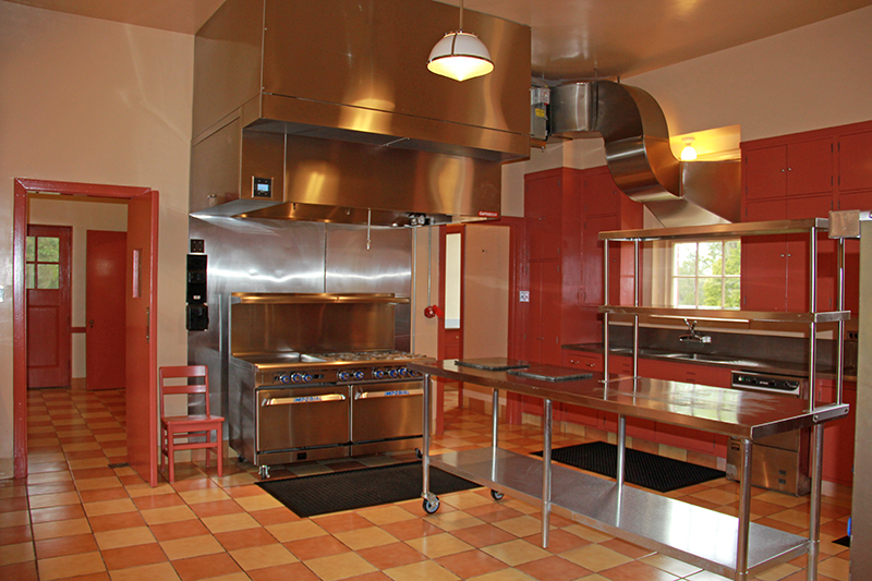 Tall Timbers hired r.e.Walsh Engineering to design a new kitchen exhaust system. The ductwork flows out of a kitchen window without marring the exterior of the building, as the old system did. Dr. George Simmons donated commercial appliances for the kitchen. The kitchen was painted in its original color scheme, the countertops were restored, and the cabinets were repaired.