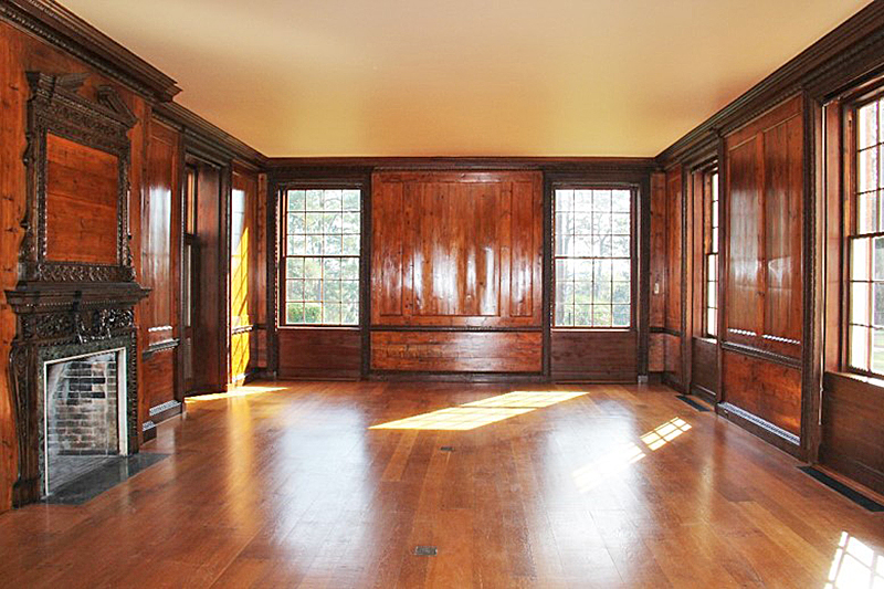 The historic paneling in the living room had been poorly refinished at some point unknown to Tall Timbers, and it was dark and dingy. After detailed surface testing and research, IFACS restored the living room paneling and trim to its original finish.